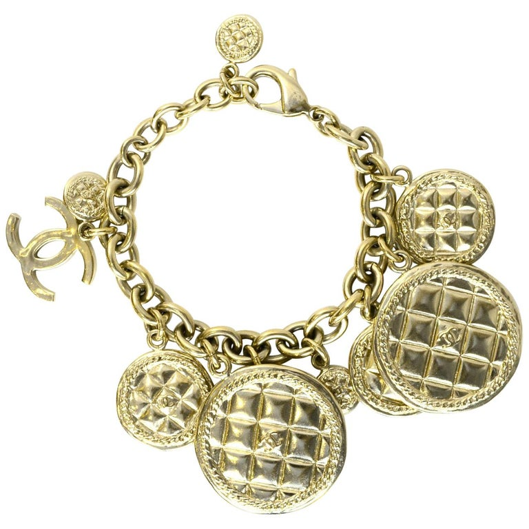 Chanel 2015 Light Goldtone Quilted Disc & CC Charm Bracelet with Box For Sale