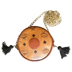 Vintage MCM brown monogram mini Suzy Wong chain shoulder purse with brown fringe