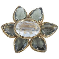 Hand set grey and clear paste daisy brooch in antiqued gilt, Christian Dior 1961