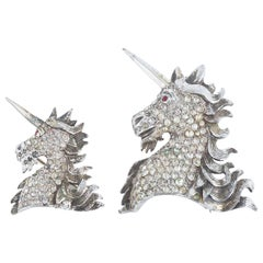 A pair of paste and gilt metal 'unicorn' brooches, Christian Dior, c1954.