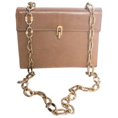 A Vintage 1970s Lizzard Handbag with a Gold Chain