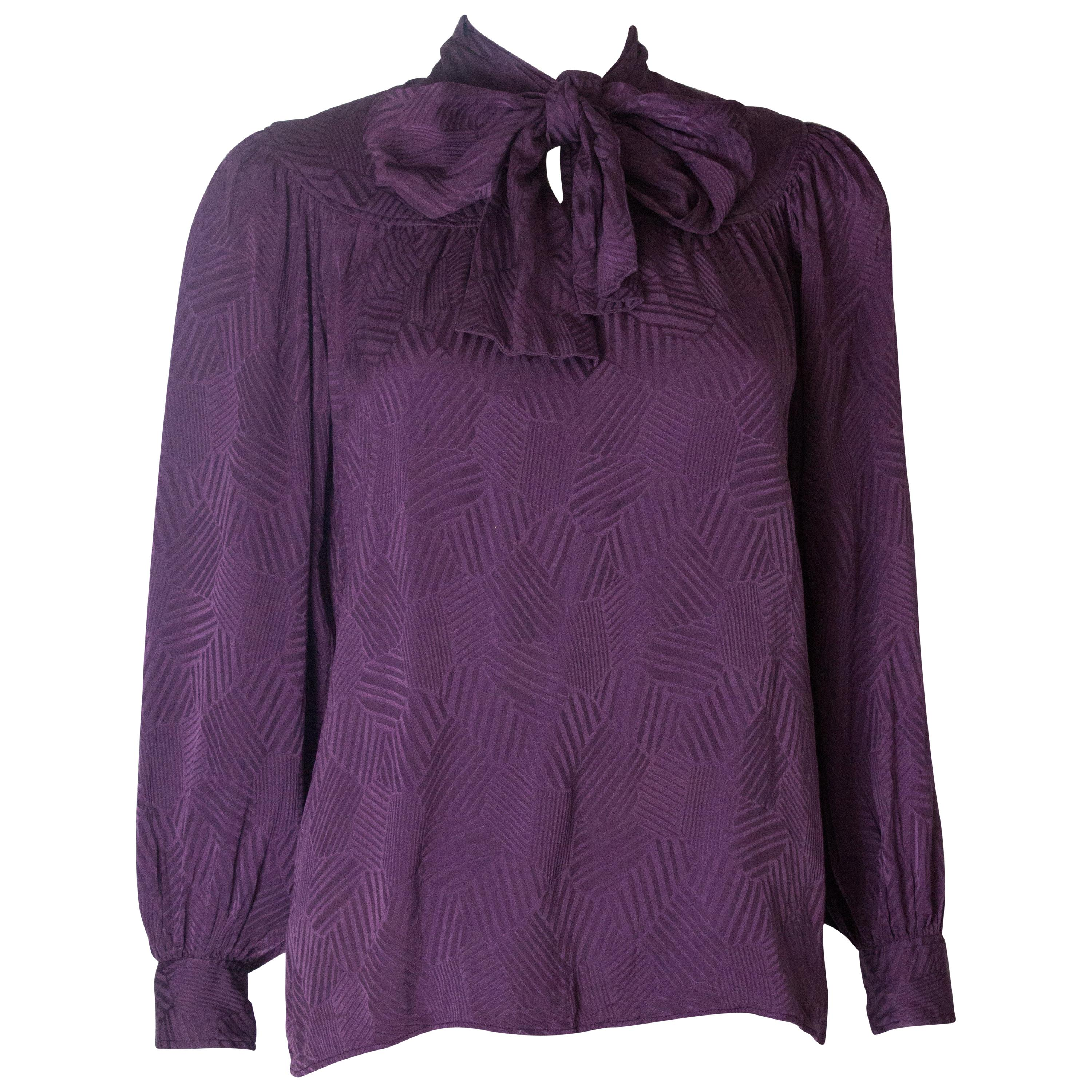 be9f32ab698fcc A Vintage 1970s silk purple pussy bow blouse by Yves Saint Laurent at  1stdibs