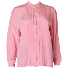 A Vintage 1990s pale pink silk button up blouse by Yves Saint Laurent