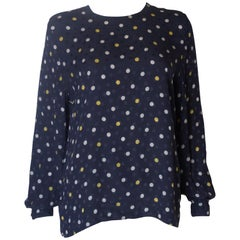 A Vintage 1990s navy polka dot silk blouse by Valentino
