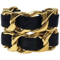 CHANEL Collector Cuff Bracelet in Gilt Metal Interlaced with Black Leather