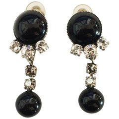 A Pair of Mid Century Onyx and Diamante earrngs by Jaques Fath