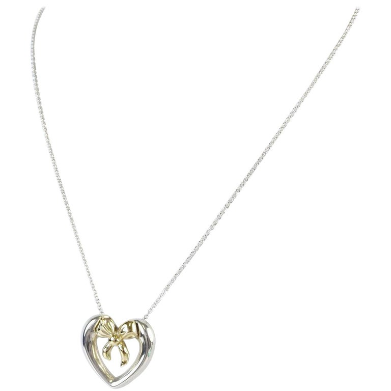 9895aa292de9c Tiffany & Co. Sterling Silver Gold Heart Bow Chain Pendant Necklace