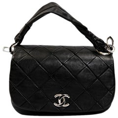 CHANEL Flap Bag in Black Quilted Lambskin Leather