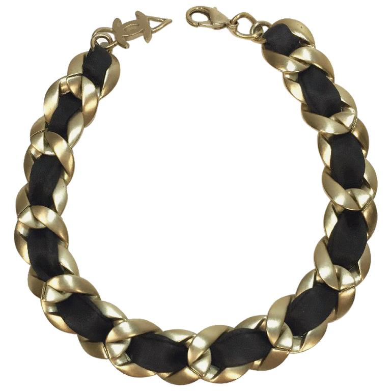 6516ff6b4ad6 Chanel Choker Necklace in Matte Gold Chain Metal Interlaced with Black  Ribbon For Sale