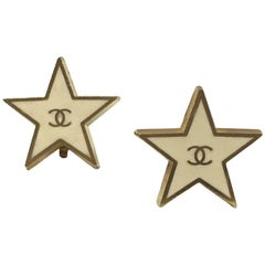 CHANEL Stars Clip-on Earrings in Gilt Metal and Ivory Resin