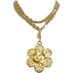 Chanel Vintage double golden skinny chain long necklace with flower CC pendant