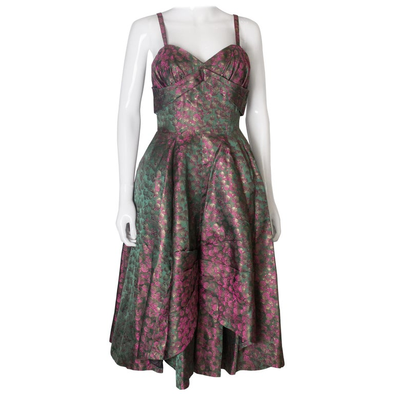 A Vintage 1950s brocade structured swing Cocktail Dress in Pink And Green For Sale