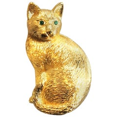 Christian Dior 1960s Cat brooch or pin in gilt metal with emerald eyes
