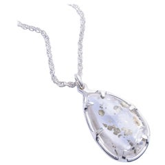 Large one of a kind pyrite quartz pendant set in sterling silver.