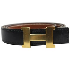 Hermes reversible H Constance Black and Gold Leather Belt. Size 84 cm