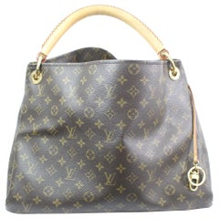 Louis Vuitton Artsy Monogram Canvas Bag.