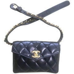 Vintage CHANEL black lamb waist bag, fanny pack with golden chain belt and CC.