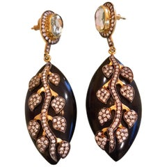 Meghna Jewels Black Resin Leaf Earrings