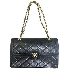 Vintage Chanel black 2.55 double flap chain bag with gold and silver CC.  Paris