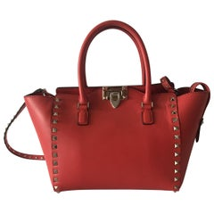 Valentino small rockstud leather handbag in cherry red