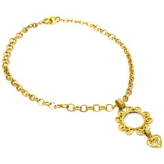Vintage Chanel thick chain long necklace with petals, glass, heart, and CC top