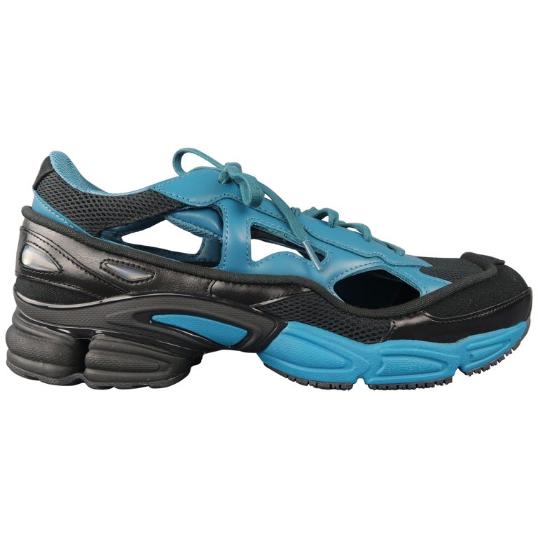 pretty nice 37432 e9ecc Adidas Raf Simons Black and Blue Replicant Ozweego Trainers
