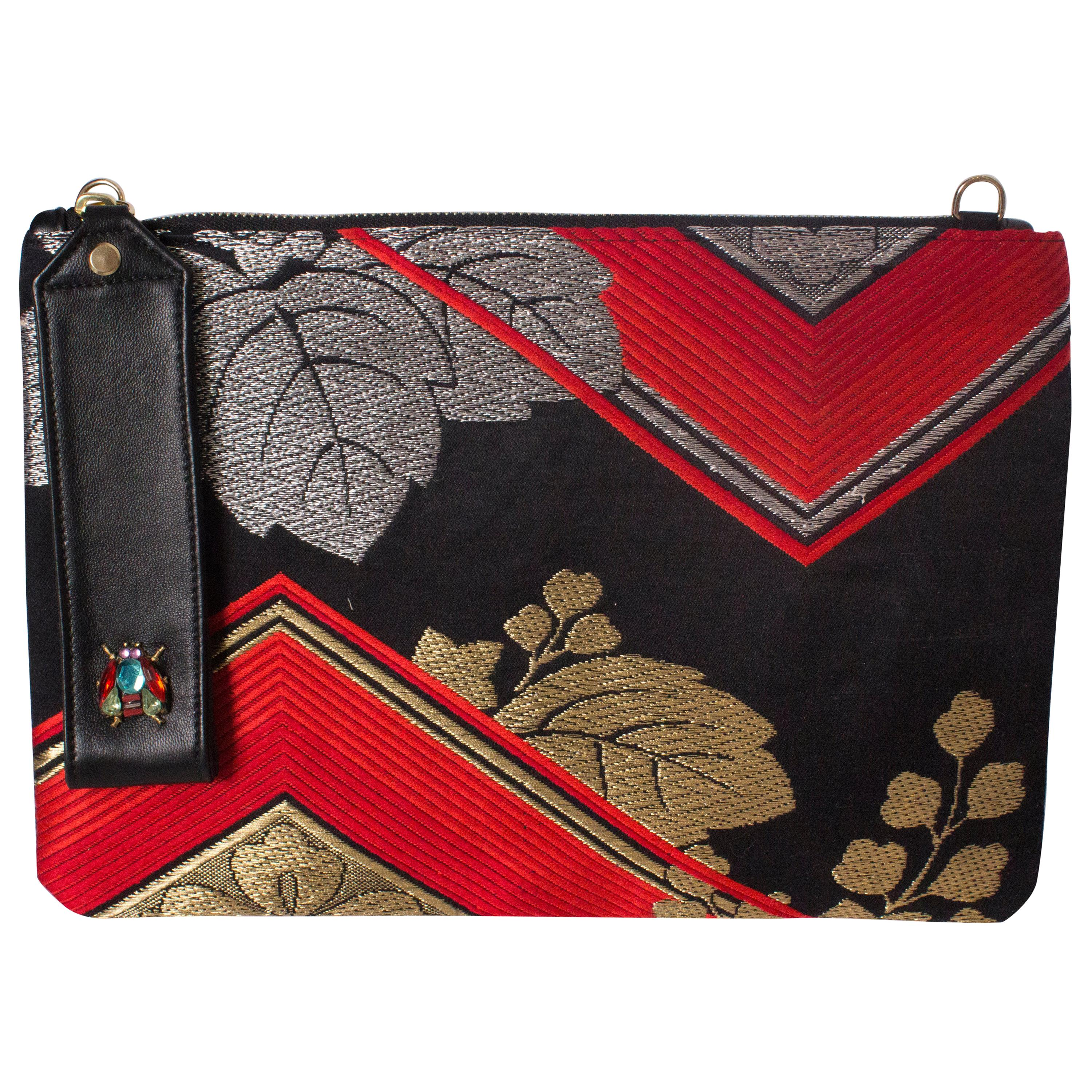 Embroidered Pouch Bag by Mame Huku