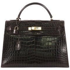 Hermes Kelly Handbag Ebene Shiny Porosus Crocodile with Gold Hardware 32
