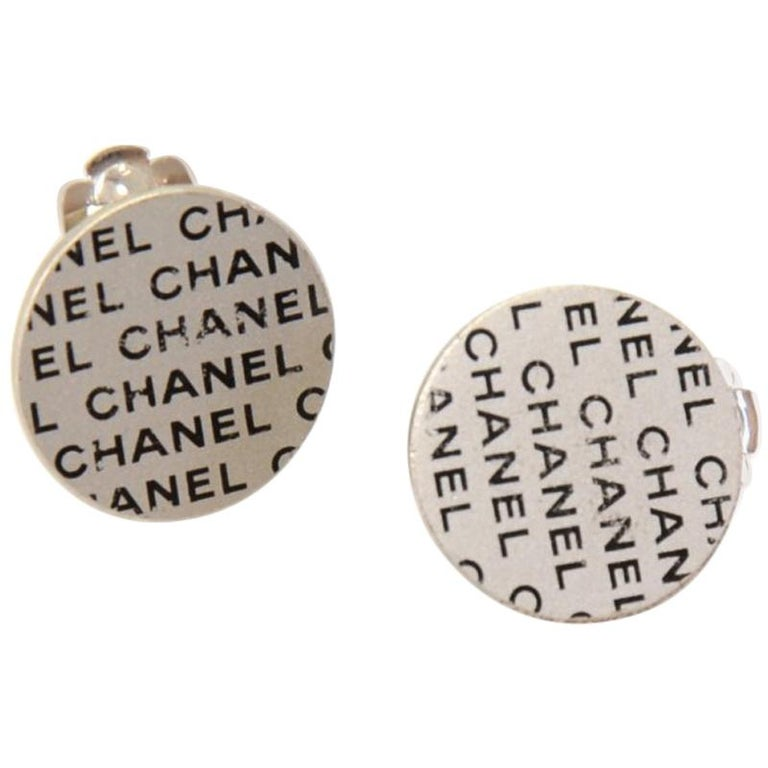 Chanel Silver And Black Logo Pattern Flat Round Earrings For Sale At