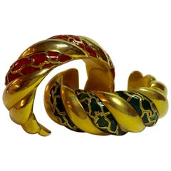 Pair of Gilt Clad Red and Green Bakelite Cuff Bracelets