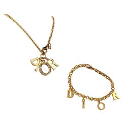 Christian Dior Gold Charm Necklace & Bracelet Jewelry Set, c. 2000s