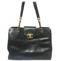 Vintage CHANEL black caviar leather Overnighter, Weekender bag, large chain bag.