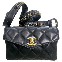 Chanel Vintage black lamb belt bag / fanny pack with golden chain belt and CC