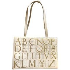 Vintage Paloma Picasso beige large shoulder bag, tote bag with gold alphabets.