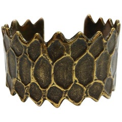 YSL's Vintage Cuff Bronze Coloring Metal