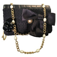 Chanel Black Boucle / Kid Leather Handbag with Camellia and CC Pearls