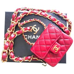 Vintage CHANEL red lambskin mini 2.55 bag charm chain leather belt with CC mark.