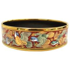 Vintage Hermes cloisonne enamel golden bangle with bird design.