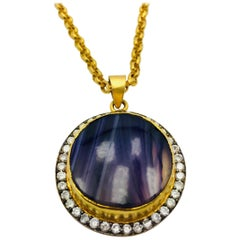 MEGHNA JEWELS Handcrafted round amethyst druzy necklace