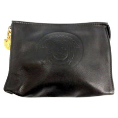 Vintage Gianni Versace black leather clutch purse, pouch, case bag with medusa.