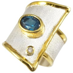 1.60 Carat Blue Topaz 24K Gold trims Fine silver 950 Overlapping Statement Ring