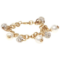 John Wind gold bracelet with pearls and crystal charms