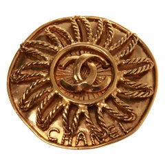 Chanel gold sun brooch with double CC