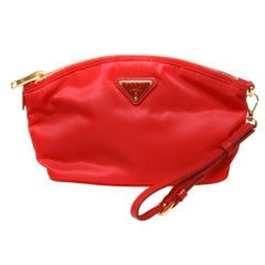 Prada small red clutch with gold hardware and red leather strap