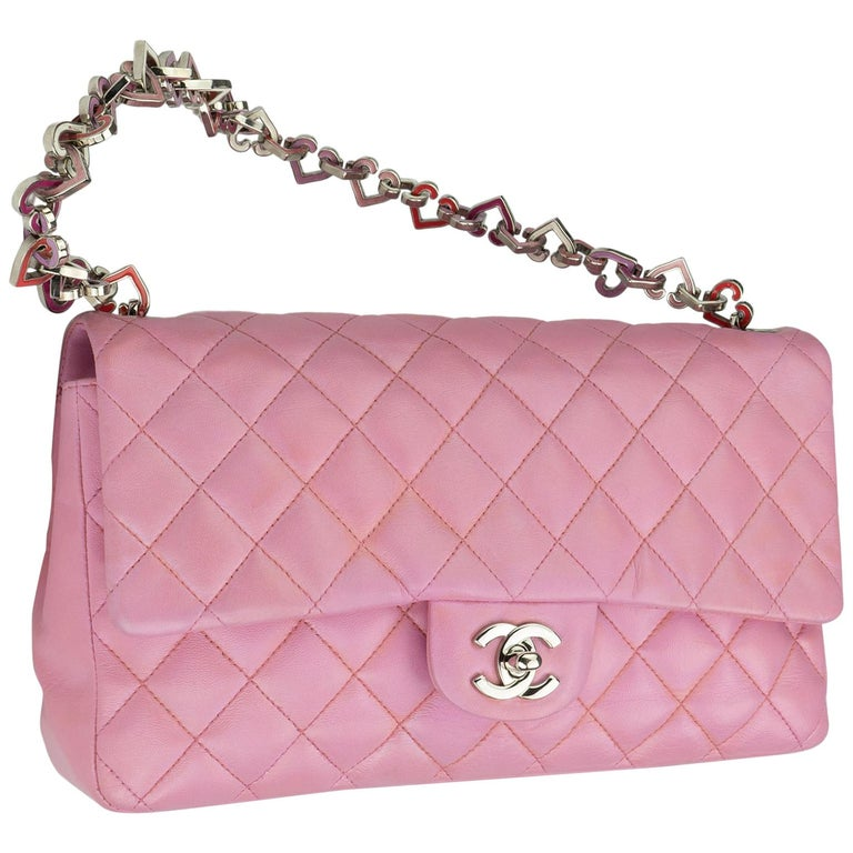 Chanel Limited Edition Pink Valentine Heart Charm Classic Flap 2004 {VINTAGE 14 Years}  Pink quilted lambskin Heart charm strap Silver CC turnlock  Classic back pocket Pink logo microfiber interior Interior zippered pocket  Handle drop: 7.5