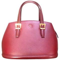 Vintage Valentino Garavani wine leather handbag with golden buckles. Classic bag