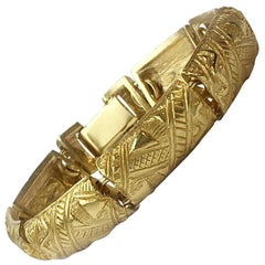 YVES SAINT LAURENT Vintage Rigid Bracelet in Gilt Metal