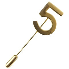 CHANEL Number 5 Pin in Gilt Metal
