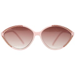 Balenciaga pink and burgundy plastic sunglasses with gold accents, 1980s