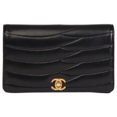 1990s Chanel Black Wave Quilted Lambskin Vintage Classic Clutch